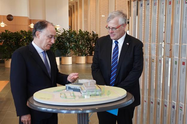 OPCW Director-General, H.E. Mr Fernando Arias shows H.E. Naor Gilon, Ambassador of Israel to the Netherlands an architectural model of the future OPCW Centre for Chemistry and Technology