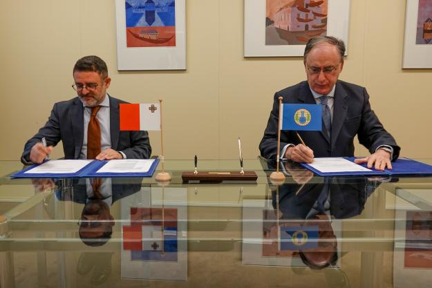 H.E. Dr Mark Anthony Pace, Permanent Representative of the Republic of Malta, and H.E. Mr Fernando Arias, Director-General of the OPCW
