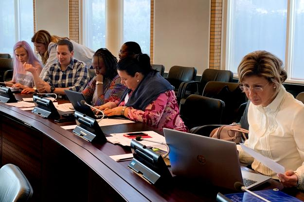 Participants during a training course on Article VI Obligations