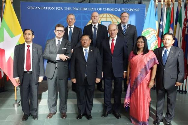 Myanmar's Foreign Minister, Mr Wunna Maung Lwin (center) and members from the delegation of Myanmar with OPCW Executive Council Chairperson Francesco Azzarello of Italy (second from left), Director-General Ahmet Üzümcü (third from right), Deputy Director-General Mrs Grace Asirwatham (second from right) and members of OPCW senior management.