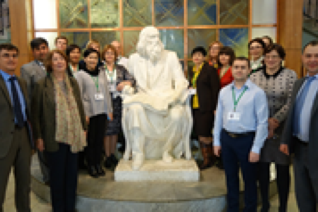 "Participants taking part in the strategic planning and decision making exercise ""Pyramid""Group photo of the workshop participants at the statue of D.I. Mendeleev at MUCTR"
