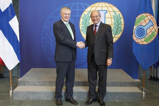 Director-General of the Organisation for the Prohibition of Chemical Weapons (OPCW), Ambassador Ahmet Üzümcü with Finland's Secretary of State at the Ministry of Foreign Affairs, H.E. Mr Peter Stenlund.
