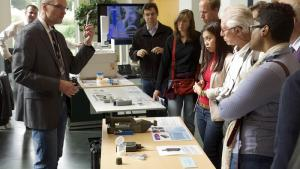 Attendees at the 2015 edition of The Hague International Day learn how inspection equipment works.