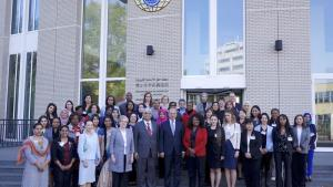 OPCW Director-General Ahmet Üzümcü and Deputy Director-General Hamid Ali Rao (both center) with participants at the Symposium on Women in Chemistry.