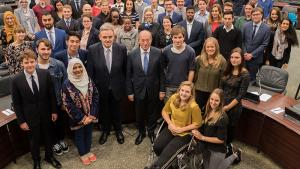 OPCW Director-General Ahmet Üzümcü (center) with students from World Class The Hague during their visit to OPCW Headquarters on 19 October 2017.