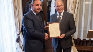 OPCW Director-General Ahmet Üzümcü (right) and the Head of the Russian National Authority, Deputy Minister of Industry and Trade, Mr Georgy Kalamanov.