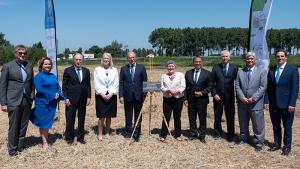OPCW Director-General, Director-General Designate, Deputy Director-General, and dignitaries at the potential site for the OPCW's Centre for Chemistry and Technology.